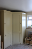 Angled Cupboard to House Boiler with Integrated Fridge Freezer